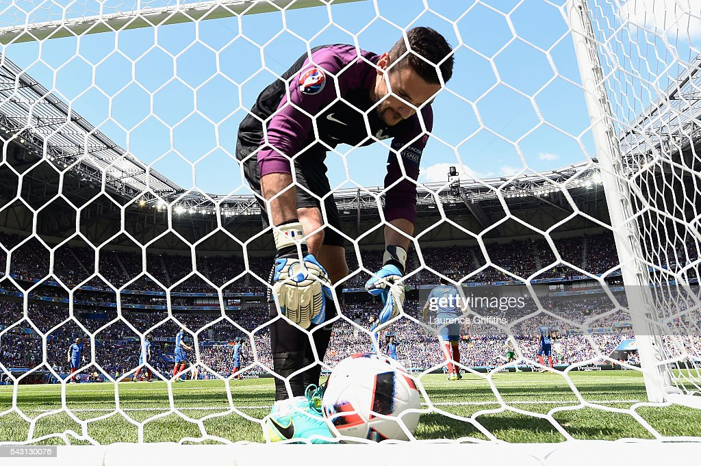 <a gi-track='captionPersonalityLinkClicked' href=/galleries/search?phrase=Hugo+Lloris&family=editorial&specificpeople=2501893 ng-click='$event.stopPropagation()'>Hugo Lloris</a> of France picks up the ball from the back of the net after Ireland's first goal during the UEFA EURO 2016 round of 16 match between France and Republic of Ireland at Stade des Lumieres on June 26, 2016 in Lyon, France.