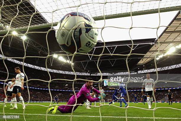 Hugo Lloris of Spurs looks behind him as the ball hits the back of the net after John Terry of Chelsea scored the opening goal during the Capital One...