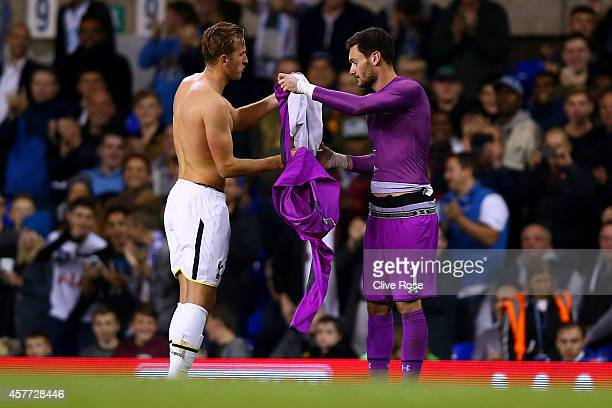 Hugo Lloris of Spurs swaps shirts with teammate Harry Kane of Spurs after he was sent off leaving Harry Kane to take care of goalkeeping duties...
