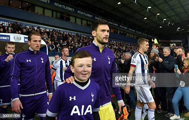 Hugo Lloris of Tottenham Hotspur and Darren Fletcher of West Bromwich Albion lead their players prior to the Barclays Premier League match between...