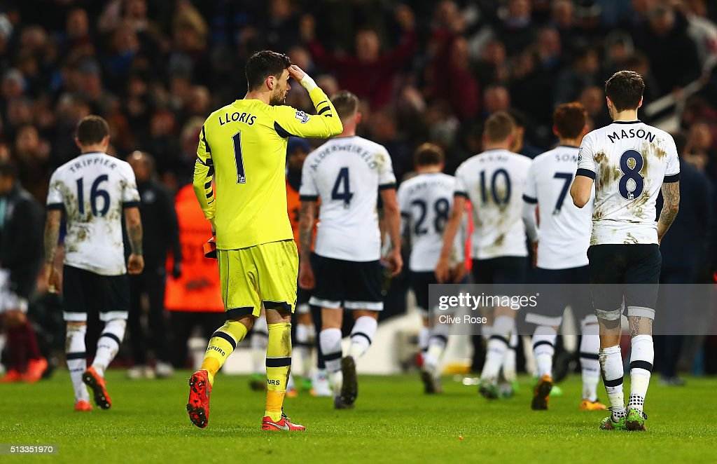 Hugo Lloris of Tottenham Hotspur and the rest of Tottenham players walk off dejected after the Barclays Premier League match between West Ham United and Tottenham Hotspur at Boleyn Ground on March 2, 2016 in London, England.