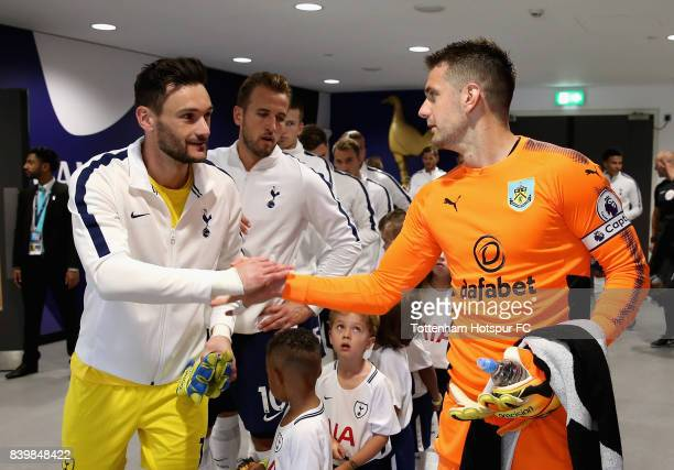 Hugo Lloris of Tottenham Hotspur and Thomas Heaton of Burnley shake hands in the tunnel prior to the Premier League match between Tottenham Hotspur...