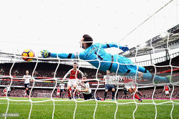 Hugo Lloris of Tottenham Hotspur attempts to save as Kevin Wimmer of Tottenham Hotspur scores an own goal for Arsenals first during the Premier...