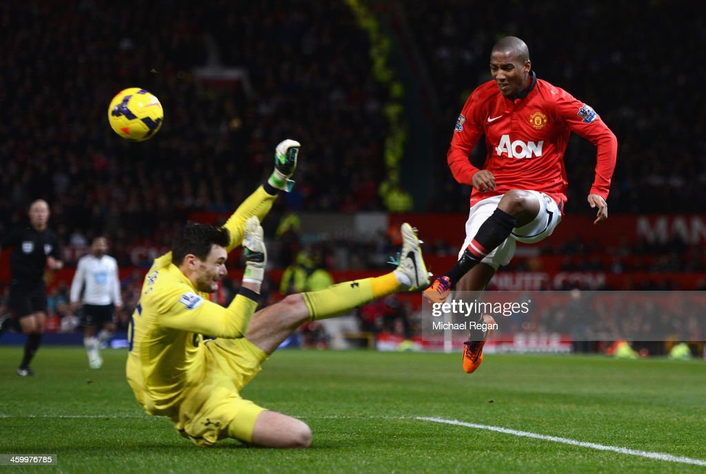 Hugo Lloris of Tottenham Hotspur blocks the attempt on goal of Ashley Young of Manchester United during the Barclays Premier League match between Manchester United and Tottenham Hotspur at Old Trafford on January 1, 2014 in Manchester, England.