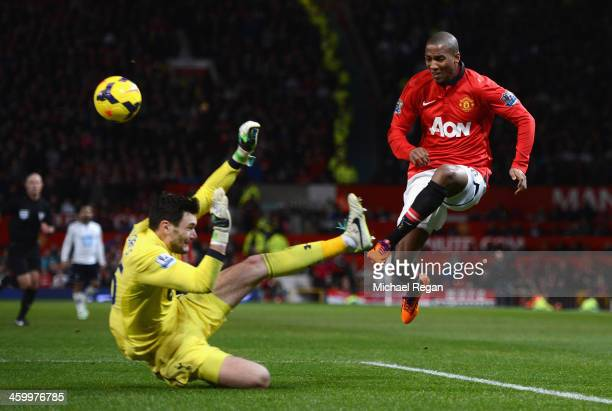 Hugo Lloris of Tottenham Hotspur blocks the attempt on goal of Ashley Young of Manchester United during the Barclays Premier League match between...