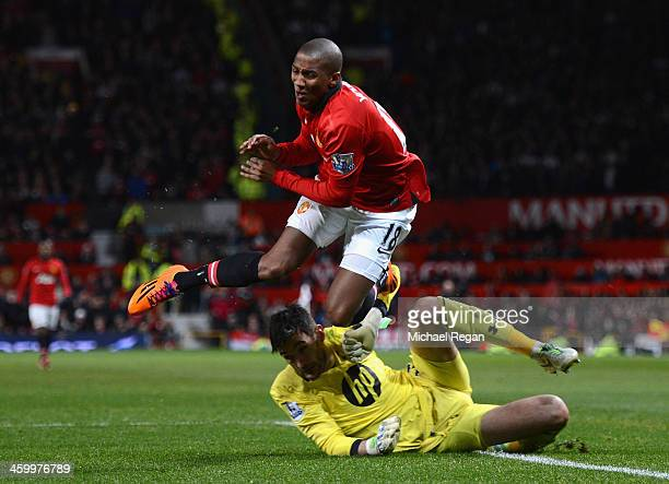 Hugo Lloris of Tottenham Hotspur collides with Ashley Young of Manchester United during the Barclays Premier League match between Manchester United...