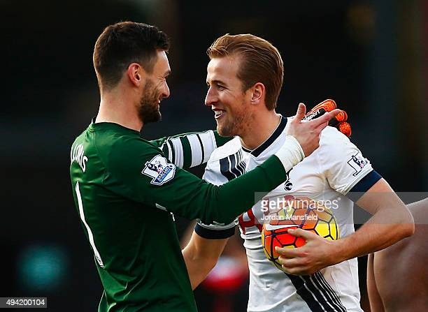 Hugo Lloris of Tottenham Hotspur conglatutes Harry Kane on his hat trick after the 51 win in the Barclays Premier League match between AFC...