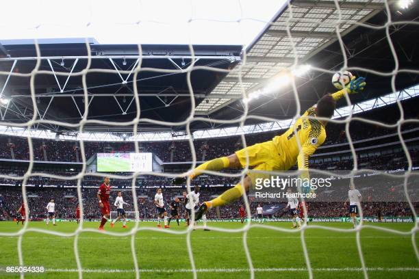 Hugo Lloris of Tottenham Hotspur dives to make a save during the Premier League match between Tottenham Hotspur and Liverpool at Wembley Stadium on...