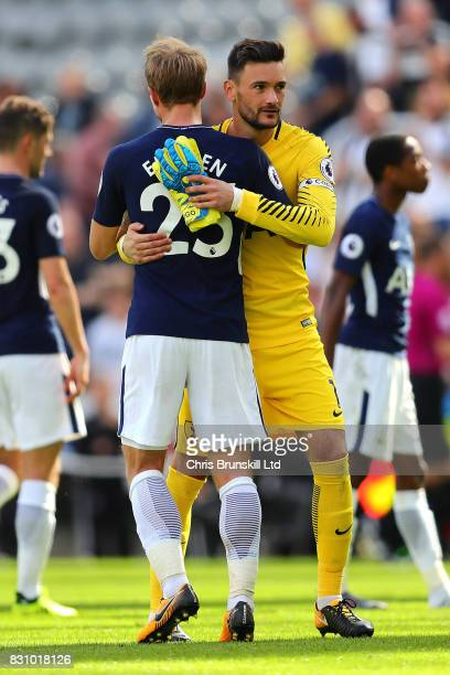 Hugo Lloris of Tottenham Hotspur embraces teammate Christian Eriksen at the end of the Premier League match between Newcastle United and Tottenham...