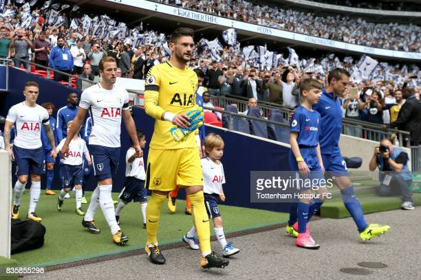 Hugo Lloris of Tottenham Hotspur leads his team out prior to the Premier League match between Tottenham Hotspur and Chelsea at Wembley Stadium on...
