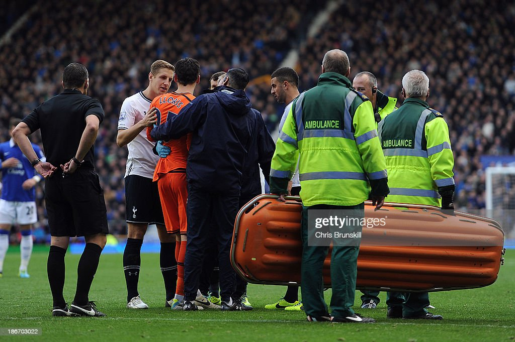 <a gi-track='captionPersonalityLinkClicked' href=/galleries/search?phrase=Hugo+Lloris&family=editorial&specificpeople=2501893 ng-click='$event.stopPropagation()'>Hugo Lloris</a> of Tottenham Hotspur leaves the field through injury during the Barclays Premier League match between Everton and Tottenham Hotspur at Goodison Park on November 03, 2013 in Liverpool, England.