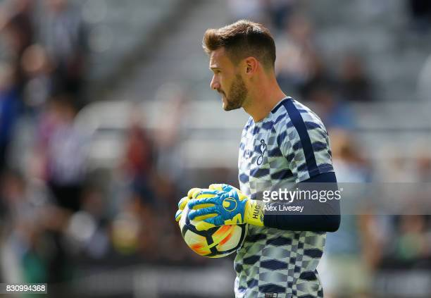 Hugo Lloris of Tottenham Hotspur looks on as he warms up prior to the Premier League match between Newcastle United and Tottenham Hotspur at St James...