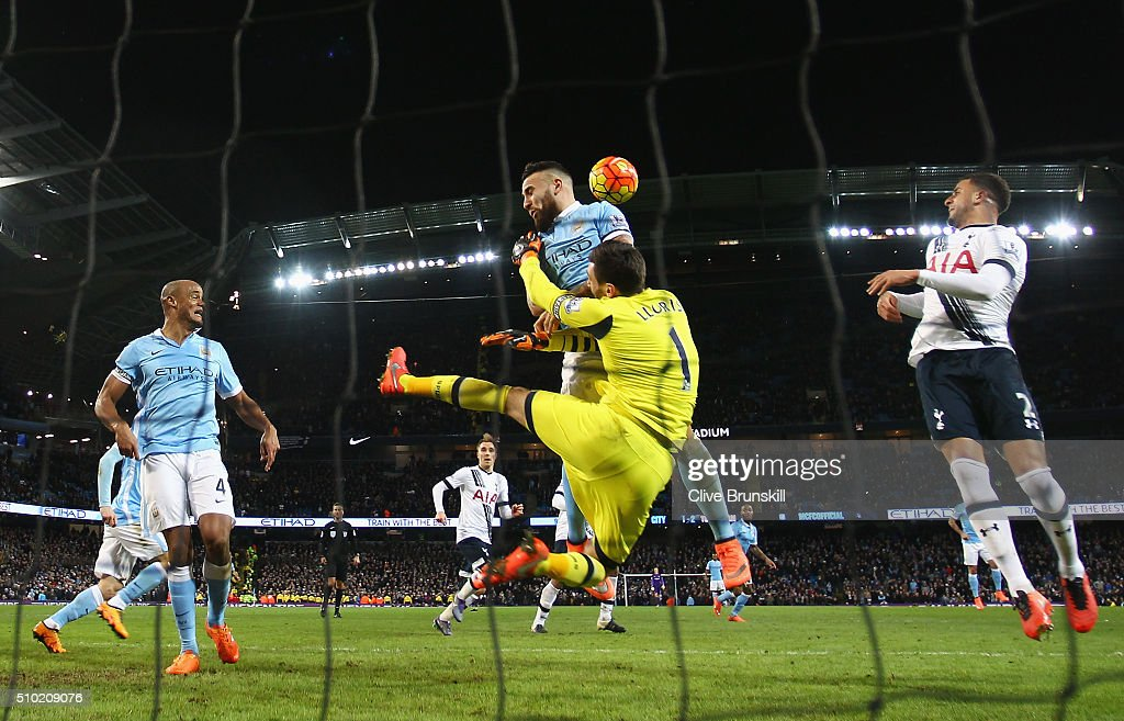 <a gi-track='captionPersonalityLinkClicked' href=/galleries/search?phrase=Hugo+Lloris&family=editorial&specificpeople=2501893 ng-click='$event.stopPropagation()'>Hugo Lloris</a> of Tottenham Hotspur makes a late save from <a gi-track='captionPersonalityLinkClicked' href=/galleries/search?phrase=Nicolas+Otamendi&family=editorial&specificpeople=5863368 ng-click='$event.stopPropagation()'>Nicolas Otamendi</a> of Manchester City during the Barclays Premier League match between Manchester City and Tottenham Hotspur at Etihad Stadium on February 14, 2016 in Manchester, England.