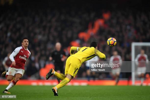 Hugo Lloris of Tottenham Hotspur makes a save during the Premier League match between Arsenal and Tottenham Hotspur at Emirates Stadium on November...