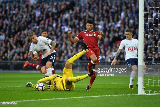 Hugo Lloris of Tottenham Hotspur saves from Alex OxladeChamberlain of Liverpool during the Premier League match between Tottenham Hotspur and...