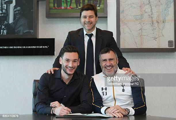 Hugo Lloris of Tottenham poses with manager Mauricio Pochettino and goalkeeping coach Toni Jimenez after signing a new contract with Tottenham...
