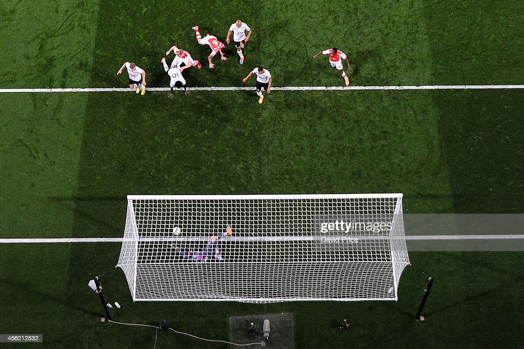 Hugo Lloris of Tottenham saves a shot from Per Mertesacker of Arsenal on the goal line during the Barclays Premier League match between Arsenal and Tottenham Hotspur at Emirates Stadium on September 27, 2014 in London, England.