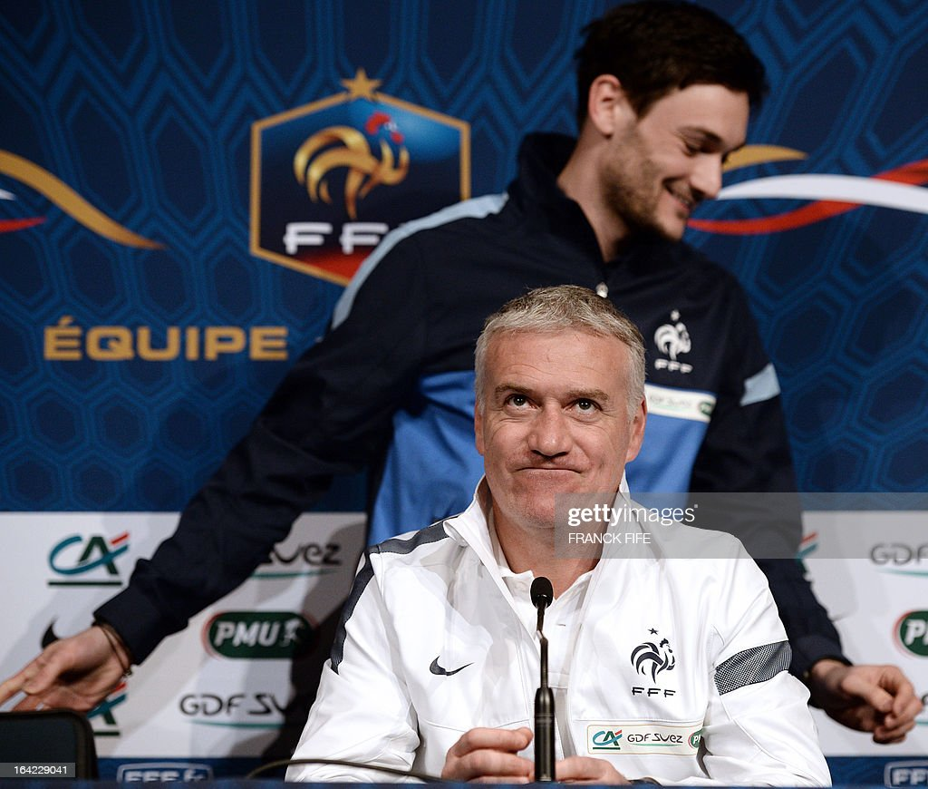 Hugo Lloris, the French national football team's goalkeeper, leaves a press conference behind head coach Didier Deschamps on March 21, 2013, on the eve of their FIFA World Cup 2014 qualifying football match France vs Georgia at the Stade de France in Saint-Denis, north of Paris. AFP PHOTO / FRANCK FIFE