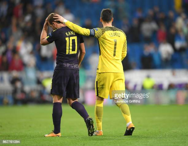 Hugo Loris of Tottenham Hotspur congratulates Harry Kane as they walk from the filed of play after earning a point in the UEFA Champions League group...