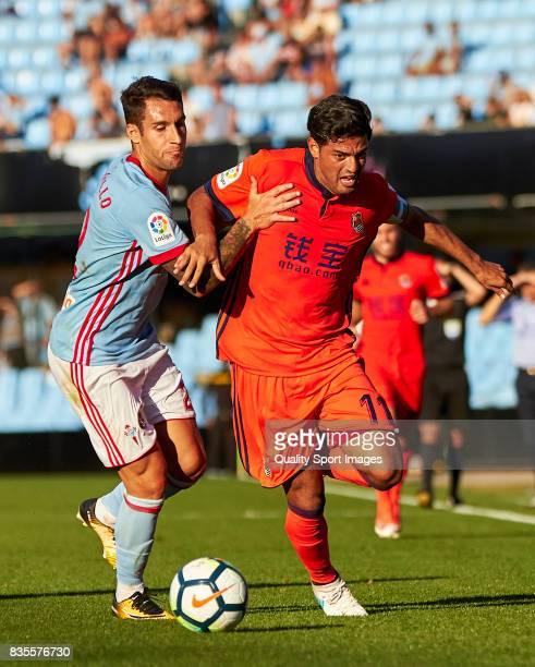 Hugo Mallo of Celta de Vigo competes for the ball with Carlos Vela of Real Sociedad during the La Liga match between Celta de Vigo and Real Sociedad...