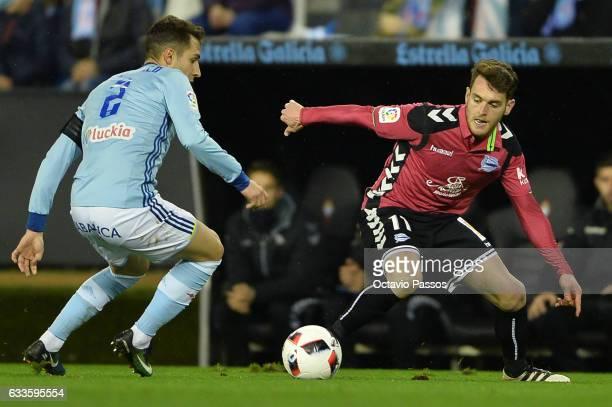 Hugo Mallo of Celta de Vigo competes for the ball with Ibai Gomez of Alaves during the Copa del Rey semifinal first leg match between Real Club Celta...