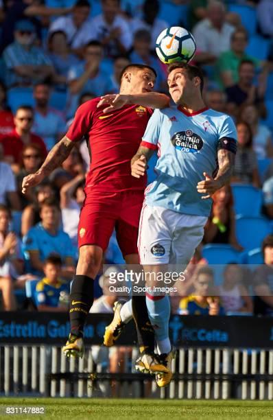 Hugo Mallo of Celta de Vigo competes for the ball with Juan Iturbe of AS Roma during the preseason friendly match between Celta de Vigo and AS Roma...