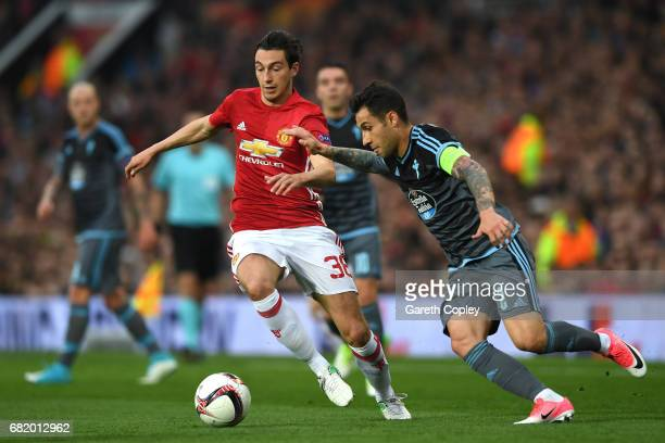 Hugo Mallo of Celta Vigo and Matteo Darmian of Manchester United in action during the UEFA Europa League semi final second leg match between...