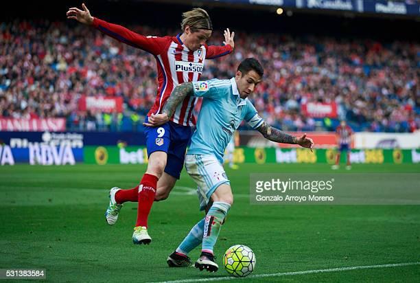 Hugo Mallo of RC Celta de Vigo competes for the ball with Fernando Torres of Atletico de Madridduring the La Liga match between Club Atletico de...