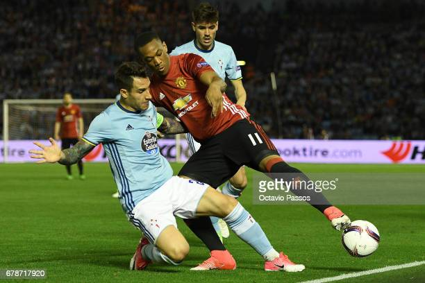 Hugo Mallo of RC Celta in action against Anthony Martial of Manchester United during the UEFA Europa League semi final first leg match between Celta...