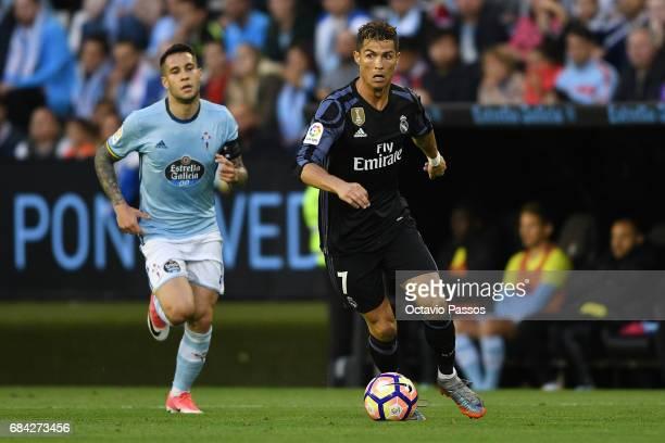 Hugo Mallo of RC Celta in action against Cristiano Ronaldo of Real Madrid during the La Liga match between Celta Vigo and Real Madrid at Estadio...
