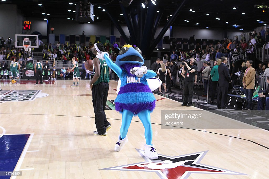 Hugo Mascot of the New Orleans Hornets tosses t-shirts to the crowd before the Sprite Uncontainable Game in Sprint Arena during the 2013 NBA Jam Session on February 15, 2013 at the George R. Brown Convention Center in Houston, Texas.