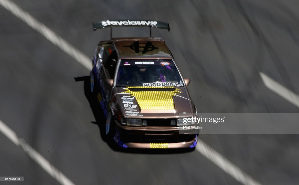 Hugo McLean of New Zealand competes in the Red Bull Drift Shifters along Victoria Street on December 8, 2012 in Auckland, New Zealand.