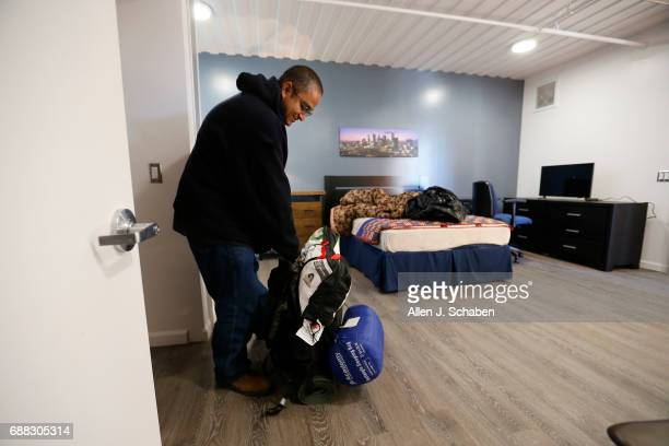 Hugo Mendez a US Army veteran who was previously homeless on and off for nine years along the Santa Ana River unpacks his backpack containing his...