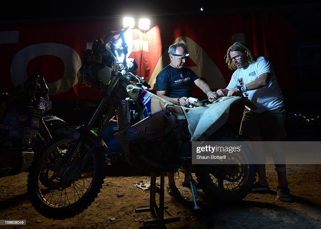 Hugo Payen of team Dorcel works on his bike after completing stage 11 from La Rioja to Fiambala during the 2013 Dakar Rally on January 16 in Fiambala, Argentina.