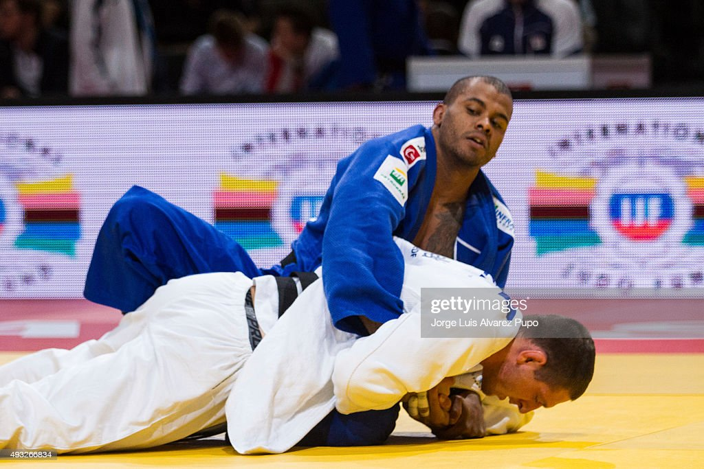 Hugo Pessanha (Blue) from Brazil holds Lukas Krpalek from Czech Republic during the Men's -100kg preliminary round of the Paris Grand Slam 2015 at the Palais Omnisports de Paris-Bercy on October 18, 2015 in Paris, France.