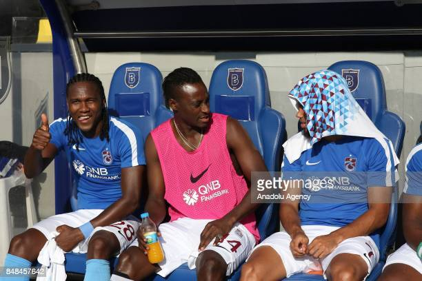 Hugo Rodallega Dame N'Doye and Theo Bongonda of Trabzonspor watch the match from players' bench during the 5th week of the Turkish Super Lig match...