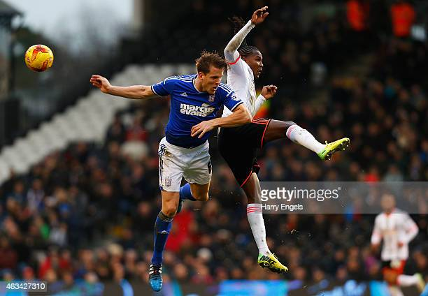 Hugo Rodallega of Fulham and Christophe Berra of Ipswich Town collide in midair during the Sky Bet Championship match between Fulham and Ipswich Town...