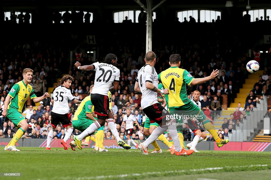 <a gi-track='captionPersonalityLinkClicked' href=/galleries/search?phrase=Hugo+Rodallega&family=editorial&specificpeople=597054 ng-click='$event.stopPropagation()'>Hugo Rodallega</a> of Fulham (20) score their first goal during the Barclays Premier League match between Fulham and Norwich City at Craven Cottage on April 12, 2014 in London, England.