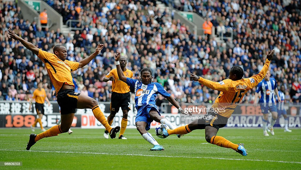Hugo Rodallega of Wigan gets in a shot despite the efforts of <a gi-track='captionPersonalityLinkClicked' href=/galleries/search?phrase=Steven+Mouyokolo&family=editorial&specificpeople=5678114 ng-click='$event.stopPropagation()'>Steven Mouyokolo</a> and <a gi-track='captionPersonalityLinkClicked' href=/galleries/search?phrase=Bernard+Mendy&family=editorial&specificpeople=661868 ng-click='$event.stopPropagation()'>Bernard Mendy</a> of Hull City during the Barclays Premier League match between Wigan Athletic and Hull City at JJB Stadium on May 3, 2010 in Wigan, England.