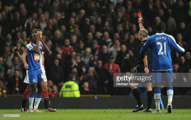Hugo Rodallega of Wigan reacts as he is sent off by referee Martin Atkinson during the Barclays Premier League match between Manchester United and...