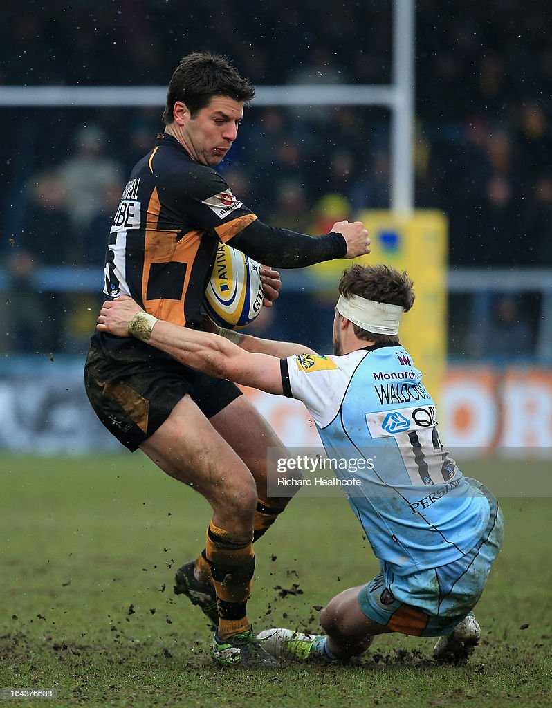 Hugo Southwell of London Wasps is tackled by Dominic Waldouck of Northampton Saints during the Aviva Premiership match between London Wasps and Northampton Saints at Adams Park on March 23, 2013 in High Wycombe, England.