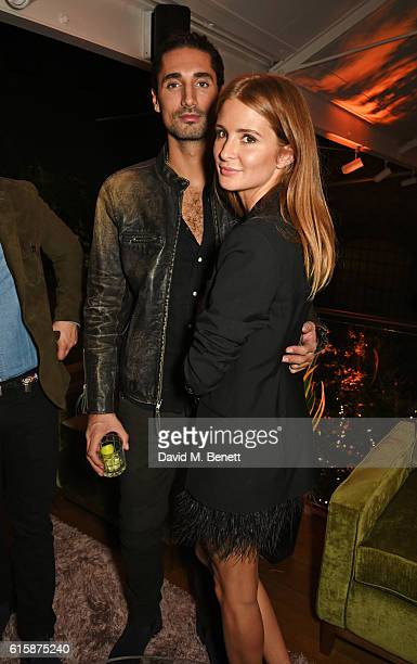 Hugo Taylor and Millie Mackintosh attend the Tatler Little Black Book party with Polo Ralph Lauren at Restaurant Ours on October 20 2016 in London...