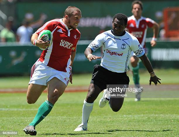 Hugo Valente of Portugal chased by Emosi Vucago of Fiji during the IRB Sevens Series match between Fiji and Portugal at Quteniqua Park on December 11...