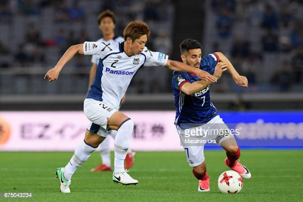 Hugo Vieira of Yokohama FMarinos and Genta Miura of Gamba Osaka compete for the ball during the JLeague J1 match between Yokohama FMarinos and Gamba...