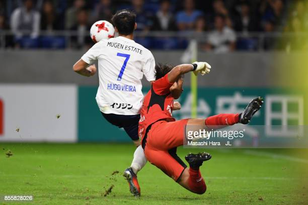 Hugo Vieira of Yokohama FMarinos and Masaaki Higashiguchi of Gamba Osaka compete for the ball during the JLeague J1 match between Gamba Osaka and...