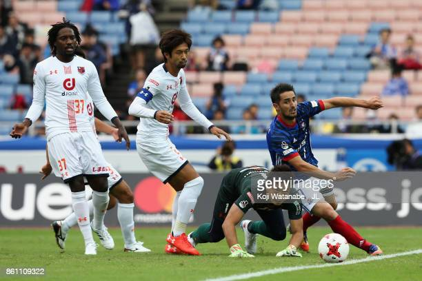 Hugo Vieira of Yokohama FMarinos and Nobuhiro Kato of Omiya Ardija compete for the ball during the JLeague J1 match between Yokohama FMarinos and...
