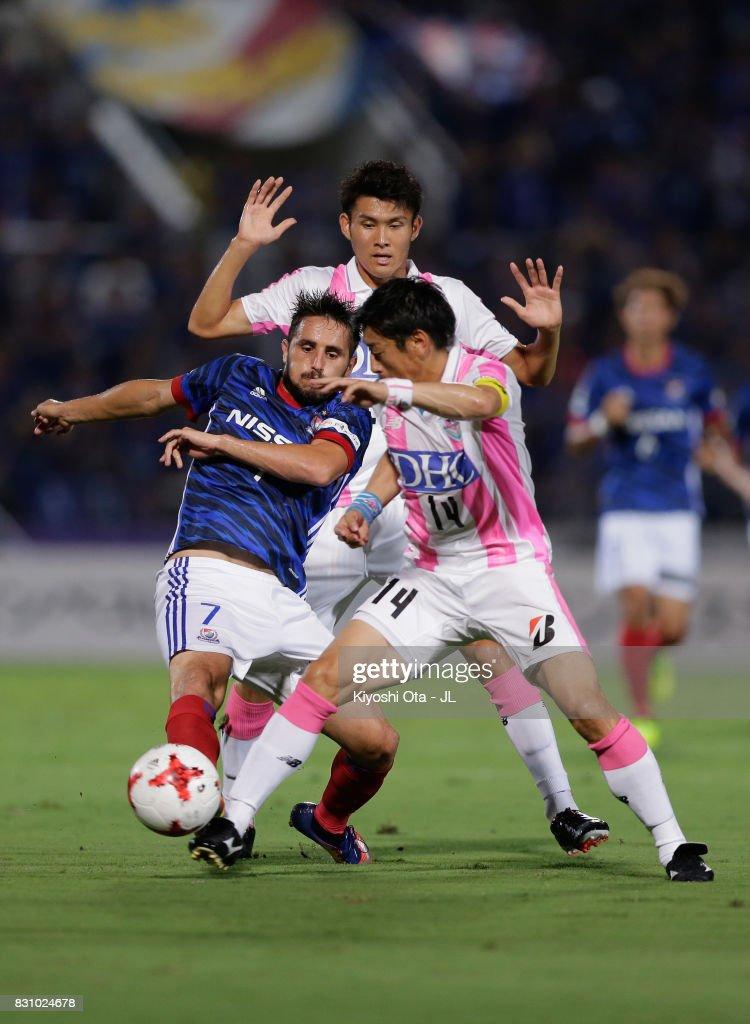 Hugo Vieira of Yokohama F.Marinos and Yoshiki Takahashi of Sagan Tosu compete for the ball during the J.League J1 match between Yokohama F.Marinos and Sagan Tosu at Nippatsu Mitsuzawa Stadium on August 13, 2017 in Yokohama, Kanagawa, Japan.