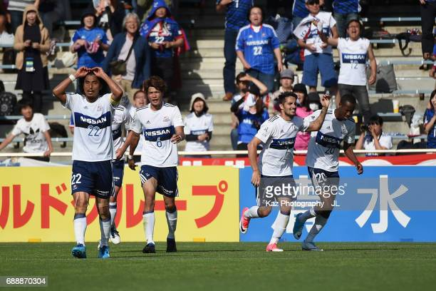 Hugo Vieira of Yokohama FMarinos celebrates scoring his side's third goal with his team mates during the JLeague J1 match between Shimizu SPulse and...