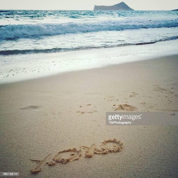 Hugs and kisses drawn in the sand on Waimanalo beach, Hawaii, America, USA