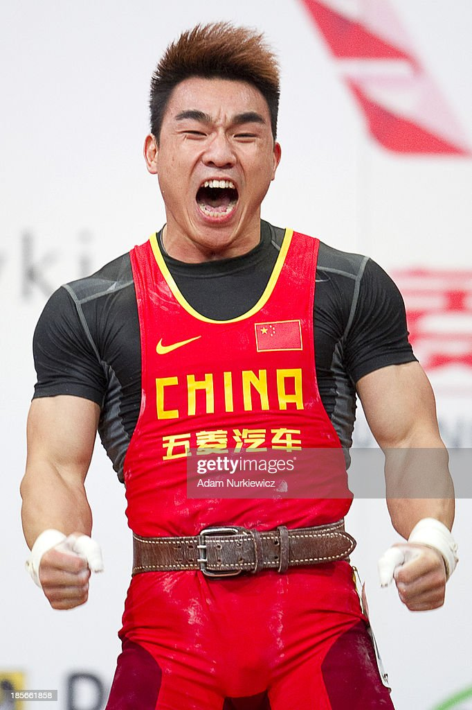 Hui Liao from China celebrates his lift and new world record in the Clean & Jerk competition in men's 69 kg Group A during weightlifting IWF World Championships Wroclaw 2013 at Centennial Hall in Wroclaw on October 23, 2013